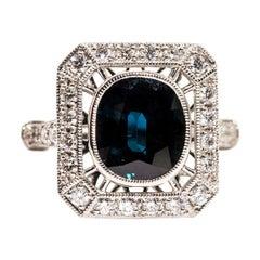 Platinum 3.97 Carat Cushion Cut Sapphire and 0.64 Carat Diamond Cluster Ring