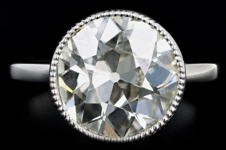 Era: New   Composition: Platinum   Primary Stone: Old European Cut Diamond  Carat Weight: Approximately 4.52 Carats  Color/Clarity: O/P - VS2  Ring Size: 6.5  Ring Weight: 7.3 Grams  Item Barcode: 542311