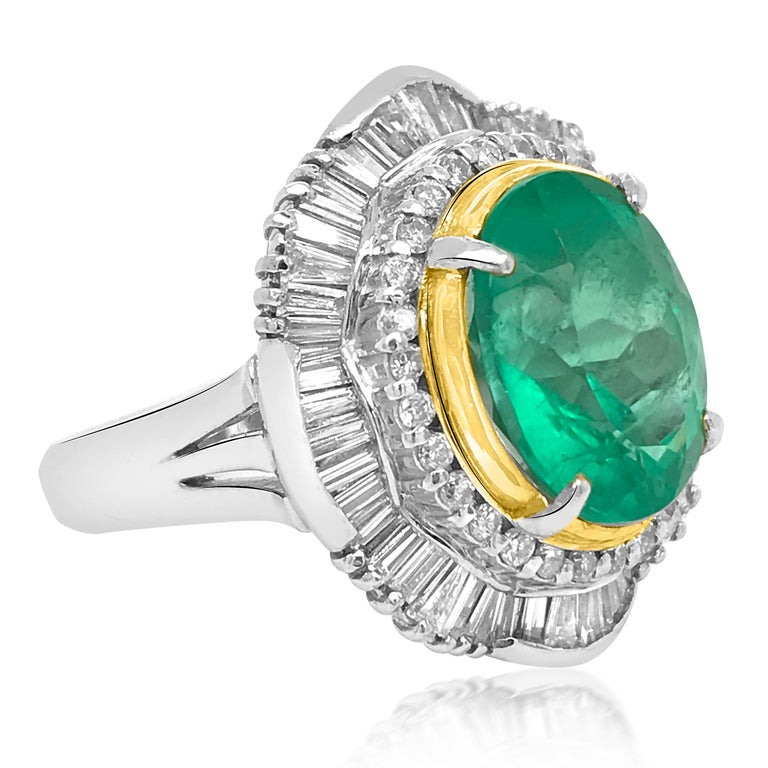 Ballerina-style emerald and diamond ring, centering on a natural oval emerald weighing approximately 5.5ct surrounded by multiple tapered baguette cut and round diamonds weighing approximately 0.85cts in total, mounted in platinum with yellow gold