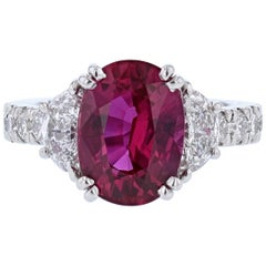 Platinum 5.61 Carat Certified Oval Cut Ruby and Diamond Ring