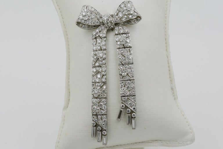 Exclusively from the Eiseman Estate Jewelry Collection, this Art Deco platinum bow pin features 215 traditional cut diamonds (6.00 ctw GH VS).