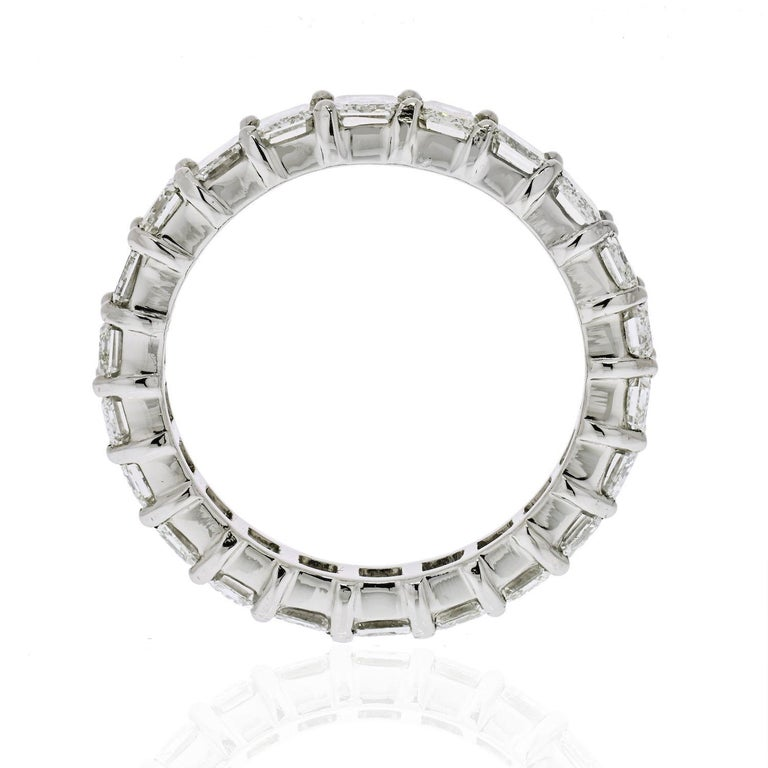 Emerald Cut Diamond Eternity Band set with 22 diamonds of 6.12 cttw. Diamond quality: G-H color, VS-SI clarity. Lustrous and shinny.  Ring Size: 7.75 Width: 5mm