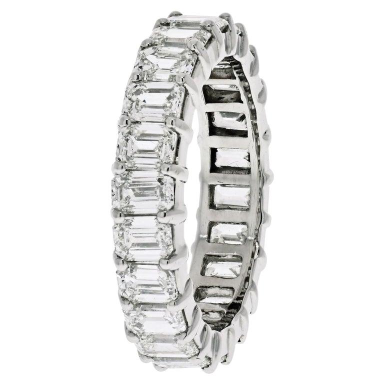 Platinum 6 Carat Emerald Cut Diamond Eternity Band For Sale