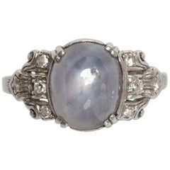 Platinum 6.3 Carat Star Sapphire and Diamond Ring
