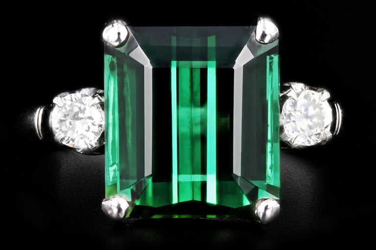 Era: Modern  Composition: Platinum  Primary Stone: Green Tourmaline  Carat Weight: 6.35 Carats  Accent Stone: Diamonds  Carat Weight: .2 Carats  Color: F-G  Clarity:  Vs1/2  Total Carat Weight: 6.55 Carats  Ring Weight: 3.8 DWT  Ring Size: