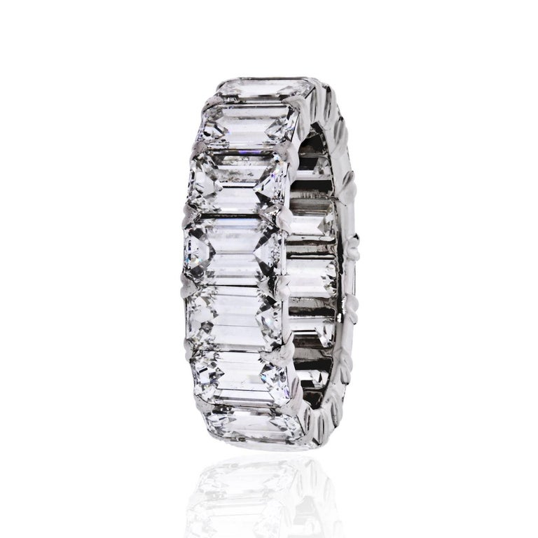 Handmade diamond eternity band crafted with emerald cut diamonds of 6.50cts.  Low set, close to the finger. Will sit well next to all engagement rings.  Width: 5.8mm Finger size 4.5.