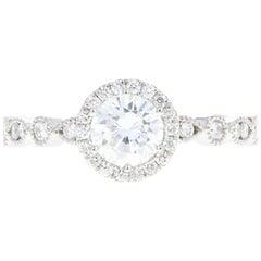 Platinum .67 Carat Round Brilliant Diamond Halo Engagement Ring