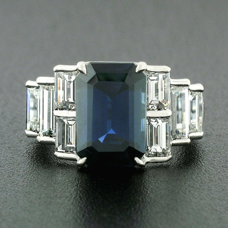 This absolutely breathtaking sapphire and diamond ring was crafted from solid .950 platinum and features a magnificent natural sapphire prong set at its center. This GIA certified sapphire is truly gorgeous and displays a stunning deep royal blue