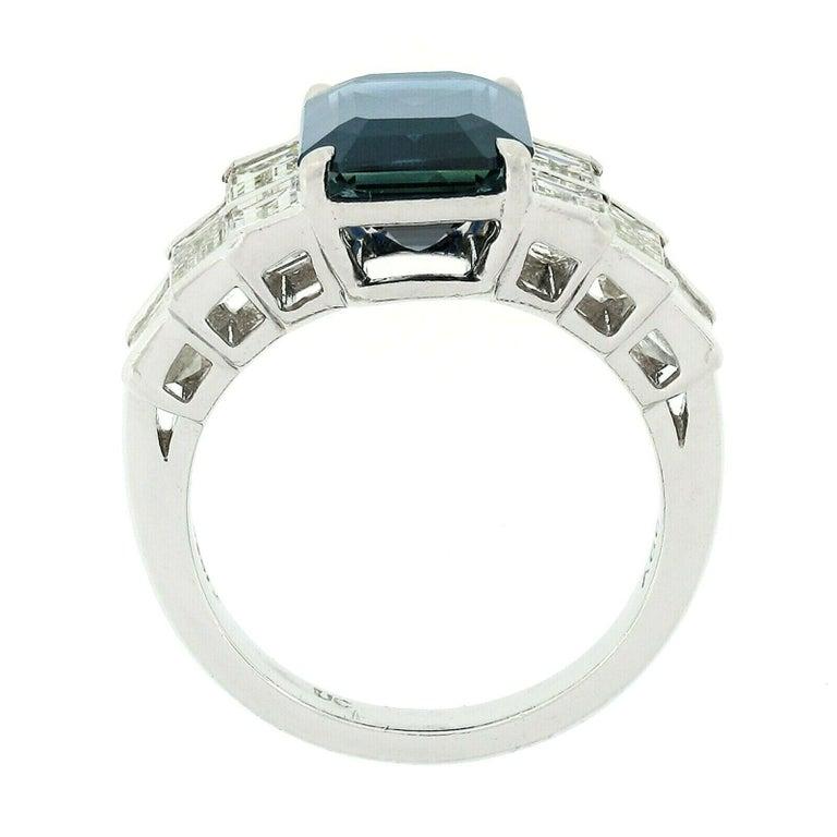 Women's Platinum 9.07ctw GIA Emerald Cut No Heat Sapphire & Large Baguette Diamond Ring For Sale
