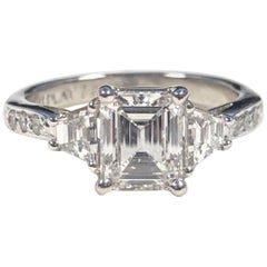 Platinum and 1 Carat Emerald Cut Diamond Engagement Ring