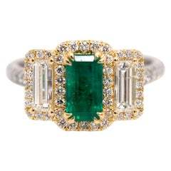 Platinum and 18 Karat Gold 1.06ct Emerald Ring with Baguettes and Round Diamonds
