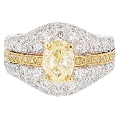 Platinum and 18 Karat Gold 1.51 Carat Certified Fancy Light Yellow Diamond Ring