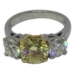 Platinum and 18 Karat Gold Natural Yellow Diamond 3-Stone Ring 2.07 Carat