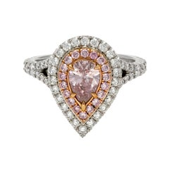 Platinum and 18 Karat Rose Gold Double Halo Diamond and Fancy Pink Diamond Ring