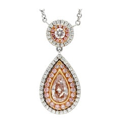 Platinum and 18 Karat Rose Gold Pear Shaped Fancy Pink Diamond Halo Pendant