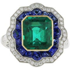 Platinum and 18 Karat Yellow Gold 3.68 Carat Emerald and Sapphire Ring