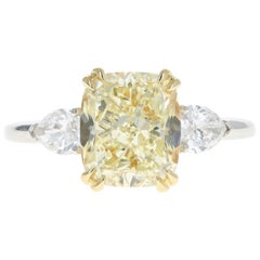 Platinum and 18 Karat Yellow Gold 4.10 Carat Cushion Cut Yellow Diamond Ring