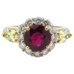 Platinum and 18 Karat Yellow Gold Burma AGL Ruby Halo and Yellow Diamond Ring