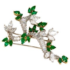Platinum and 18 Karat Yellow Gold Emerald and Diamond Brooch