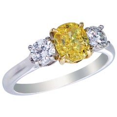 Platinum and 18 Karat Yellow Gold Ring, Fancy Intense Yellow Diamond GIA