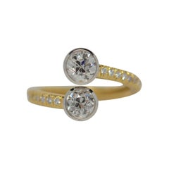 Platinum and 18k Gold By Pass Ring with Old Mine Cut and Round Diamonds, 1.09ct