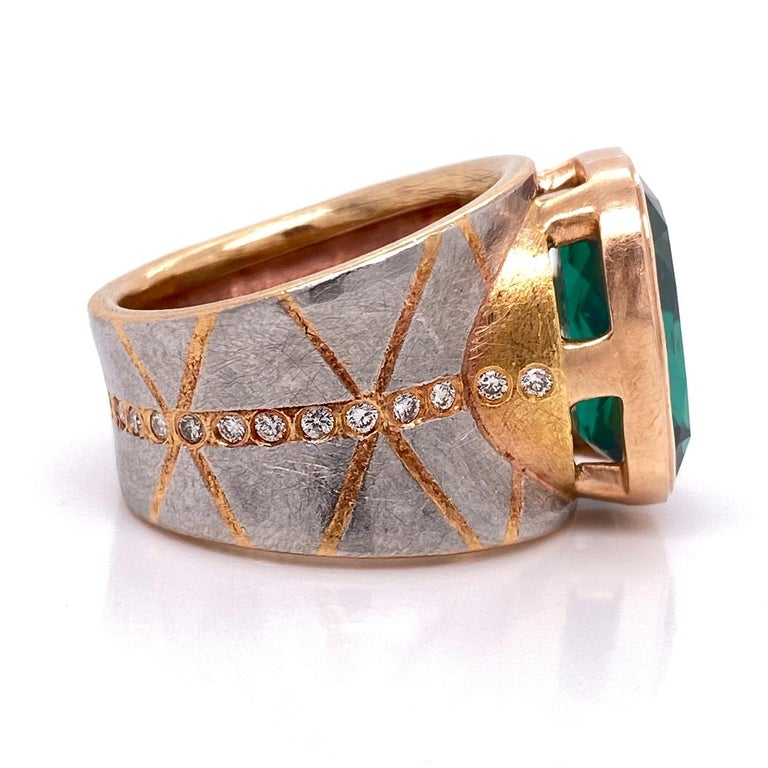 Contemporary Platinum and 18 Karat Rose Gold Lens Cut Green Tourmaline Ring with Diamonds For Sale