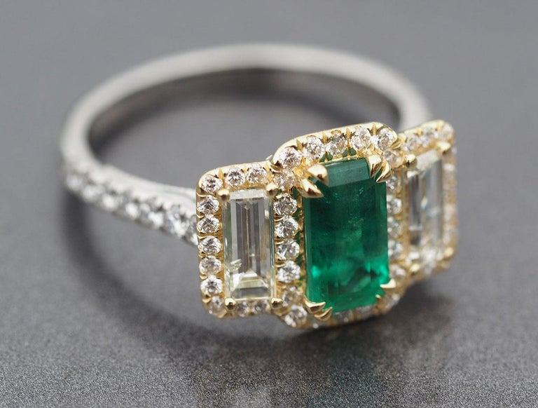 Please see this hand created (here in our custom creation department) beautiful Platinum and 18k Yellow Gold Emerald Ring with Straight Baguette Diamonds and Round Brilliant Cut Diamonds in a dual halo.   This custom creation contains the following