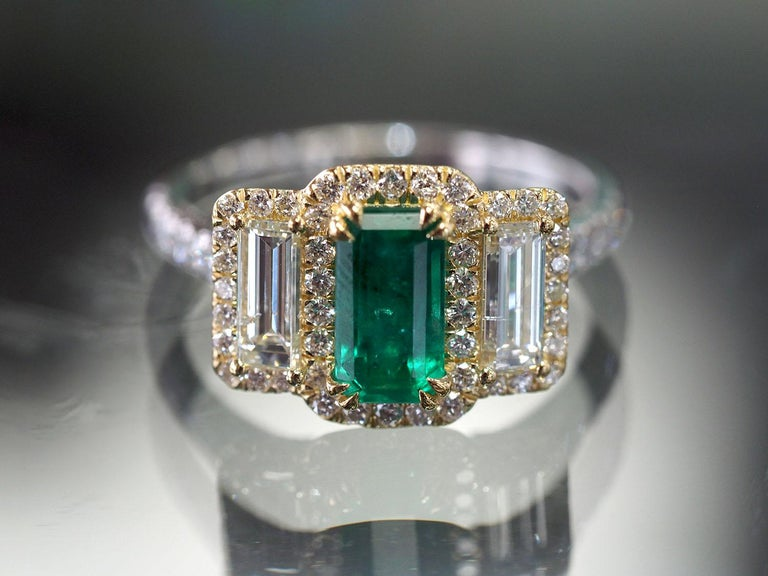 Emerald Cut Platinum and 18 Karat Gold 1.06ct Emerald Ring with Baguettes and Round Diamonds