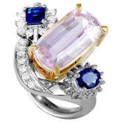 Platinum and 18K Yellow Gold Round and Tapered Baguette Diamonds, Sapphire and K