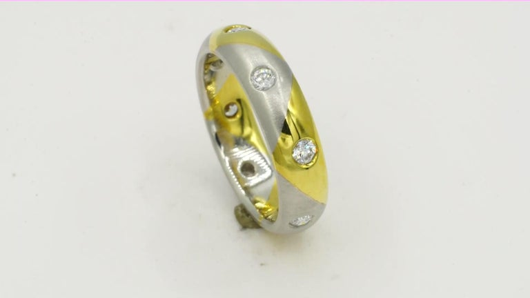 Platinum and 18kt yellow gold flush set round brilliant diamond eternity band of 5 mm in wide. Size 6 1/2. The band has  alternating sections of polished 18kt yellow gold and satin finish platinum with eight round brilliant diamonds of .44cttw,