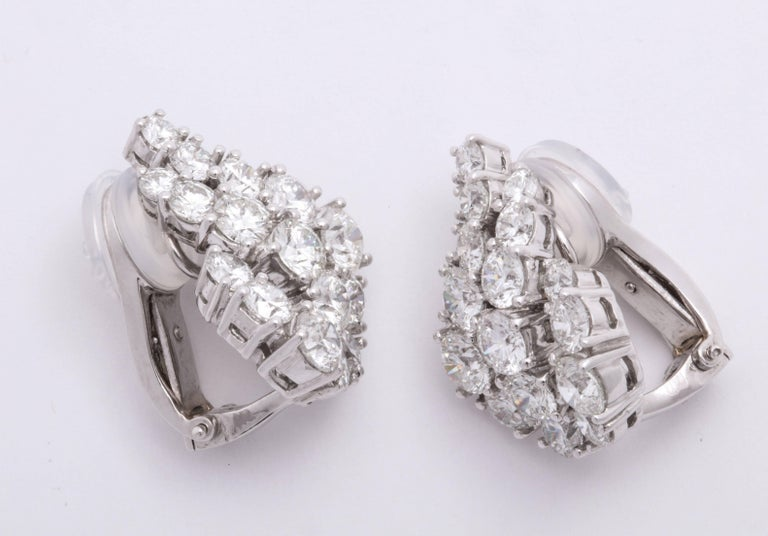 Chic and dynamic stylized platinum WINGS earrings decorated with round brilliant-cut diamonds: 7.34 carats. Concealed kidney wire on the back to suspend (optional) detachable pendants.  French clips, no post.  Dimensions: Length: 5/8 inches Width: