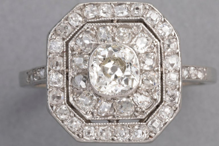 Delicate antique ring, made in France circa 1920.  The quality of the making is exceptionnal, the old cue diamonds are white and clear. They shine very well.  Mounted with platinum and high quality old European cut diamonds.  The central diamond
