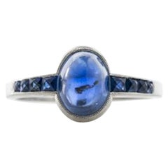 Platinum and French Cut Sapphires Featuring a 1.3 Carat Cabochon Sapphire Ring