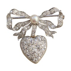 Platinum and Gold Bow and Heart Locket Brooch Set with Diamonds and a Pearl