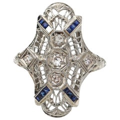 Platinum and Gold Shield Ring with Diamonds and Sapphires, circa 1920s