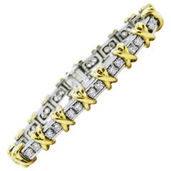 "Platinum and Gold Two-Tone Diamond Tennis Bracelet with ""X"" Motif"
