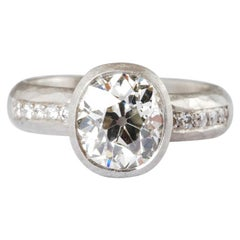 Platinum Antique Cushion Old Cut Diamond Ring 1.73cts and Channel Set Diamonds