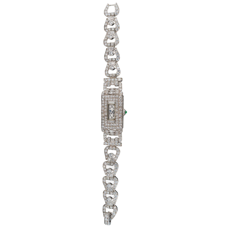 Platinum Art Deco 1920s Longines 14 Carat Diamond Emerald Egyptian Revival Watch