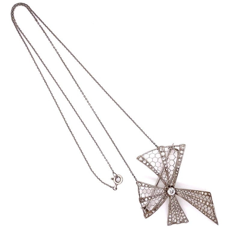 Platinum Art Deco Bow Brooch Necklace 1.00 Carat Diamonds 10.2g In Excellent Condition For Sale In Miami, FL
