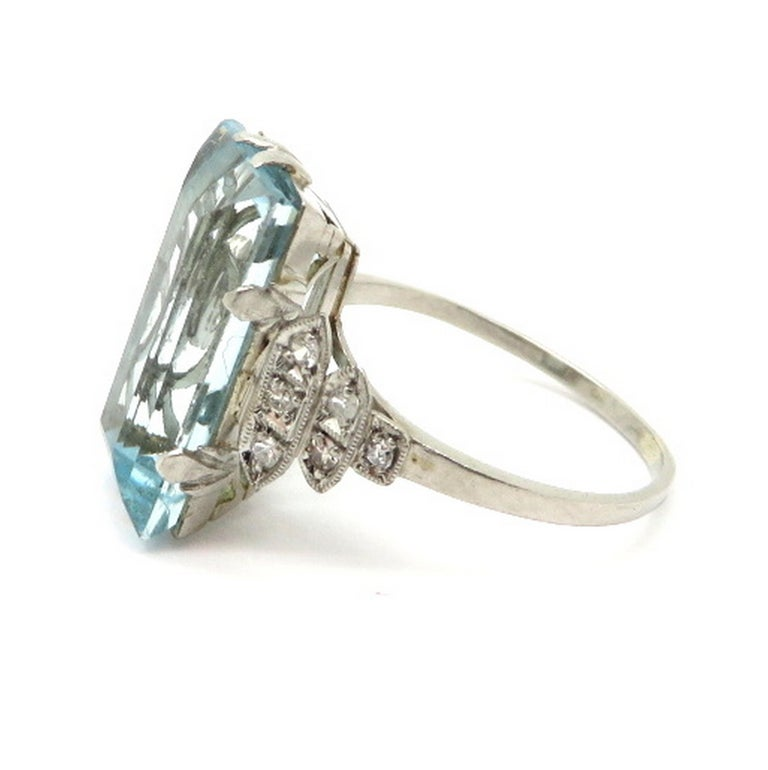 Platinum Art Deco style 5.00 carat aquamarine and diamond ring. Showcasing one fine quality Emerald cut aquamarine weighing approximately 5.00 carats. Accented with 12 single cut bead set diamonds weighing approximately 0.12 carats. Circa 1920-1930.