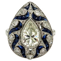 Platinum Art Deco Style Pear Shaped Diamond and Sapphire Engagement Ring