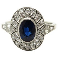 Platinum Art Deco Style Round and Baguette Diamond and Sapphire Ring