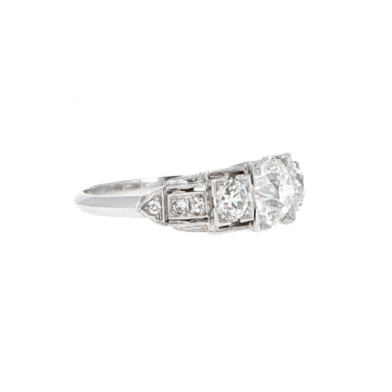Platinum art deco three-stone diamond ring. The ring has a center diamond weighing 1.16 carats. The center stone is  an old european cut diamond.  The ring is in excellent condition