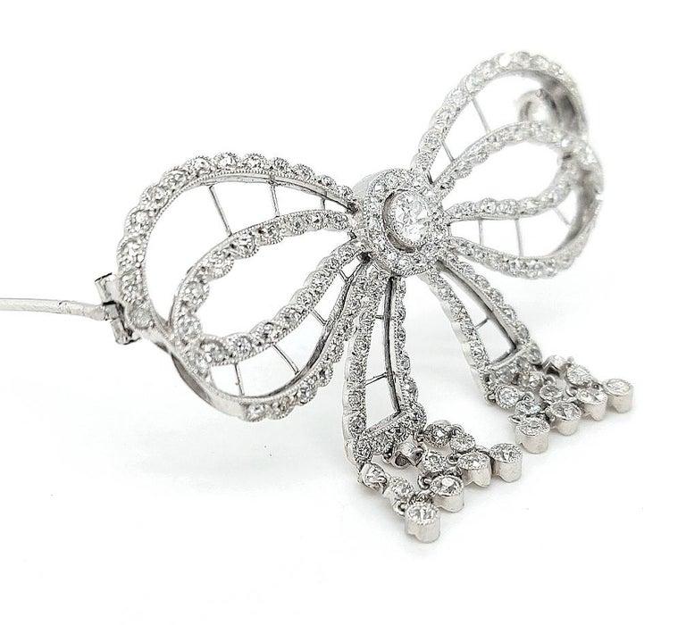 Art Deco Platinum Artdeco Bowknot Diamond Brooch with Dangling Diamonds For Sale