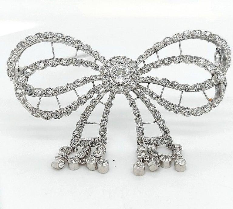 Round Cut Platinum Artdeco Bowknot Diamond Brooch with Dangling Diamonds For Sale