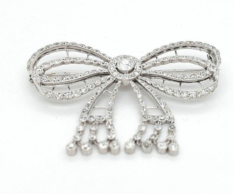 Women's or Men's Platinum Artdeco Bowknot Diamond Brooch with Dangling Diamonds For Sale