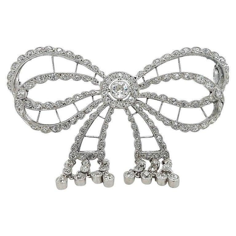 Platinum Artdeco Bowknot Diamond Brooch with Dangling Diamonds For Sale