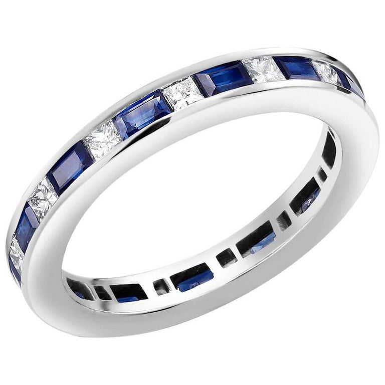 Contemporary Platinum Baguette Sapphire Alternating Princess Cut Diamond Eternity Ring For Sale