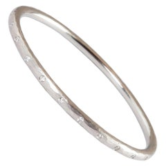 Platinum Bangle with Pear Shaped and Round Brilliant Cut Diamonds