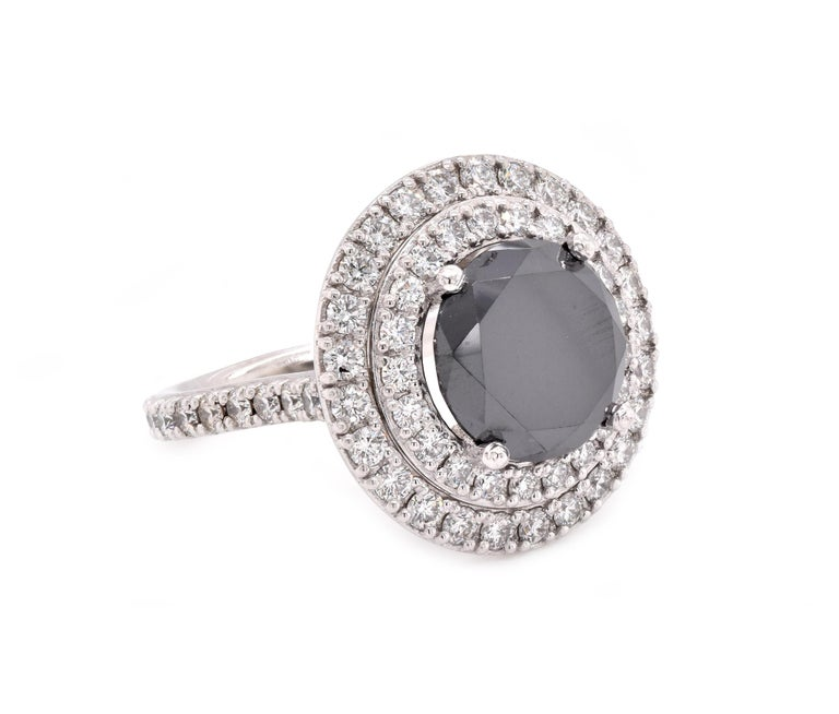 Material: Platinum  Center Diamond: 1 round brilliant cut = 4.67ct Color: Black Diamonds: 65 round cut = 1.32cttw Color: G Clarity: SI1 Ring Size: 7 (please allow up to 2 additional business days for sizing requests) Dimensions: ring shank measures